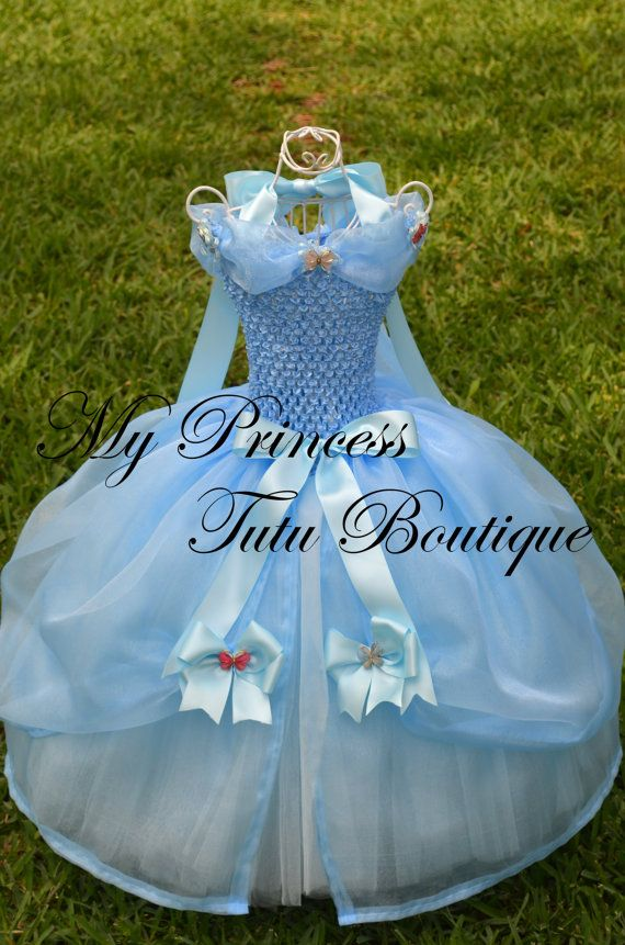 Listing is for a size 12 months - 2T  This is one of our new Cinderella dresses from the new Cinderella movie. It is has many yards of tulle