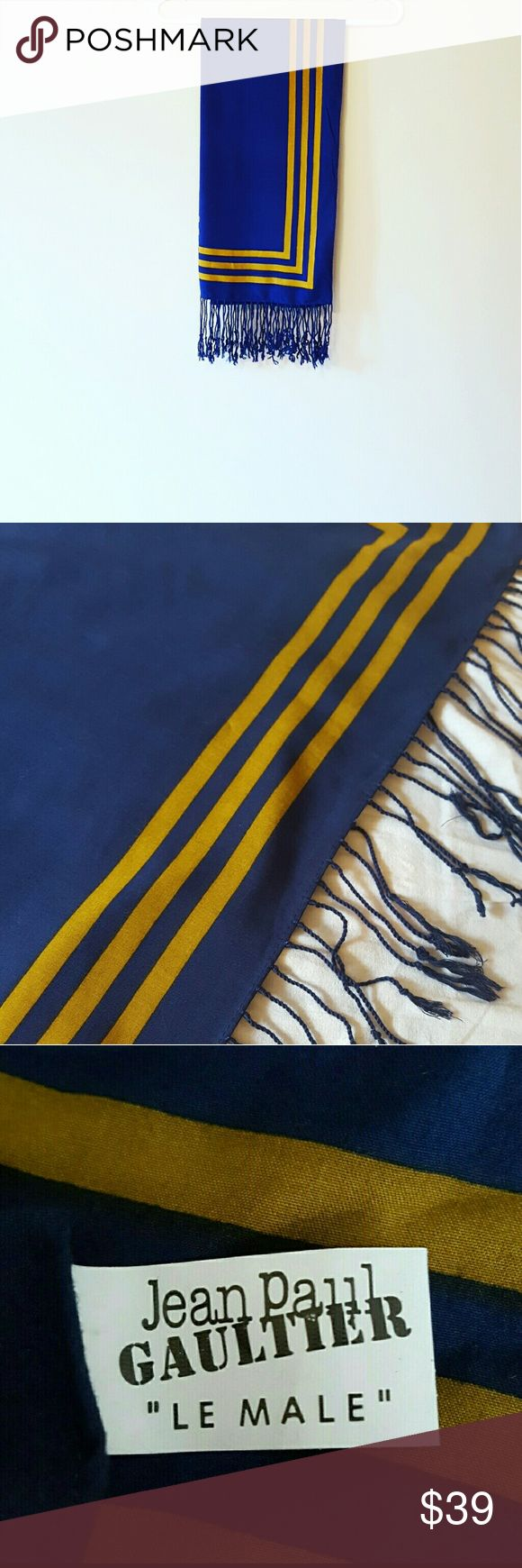 "Jean Paul Gaultier ""Le Male"" Scarf Jean Paul Gaultier ""Le Male"" Scarf 35"" x 36""  Fringe on one edge  Royal Blue Scarf with Mustard Yellow Triple Border Top is in excellent condition  *The underside has white spotting, probably undyed thread. I have not tried washing it. *See last 2 photos for white spots 100% Viscose Jean Paul Gaultier Accessories Scarves & Wraps"