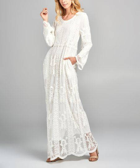 a27587949c All over lace brings a delicate touch of feminine appeal to this long  sleeve maxi dress.