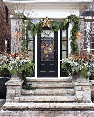 I am assuming most of this plantation was added for the holidays, interesting front door, I like the black against the cool tones of the stone