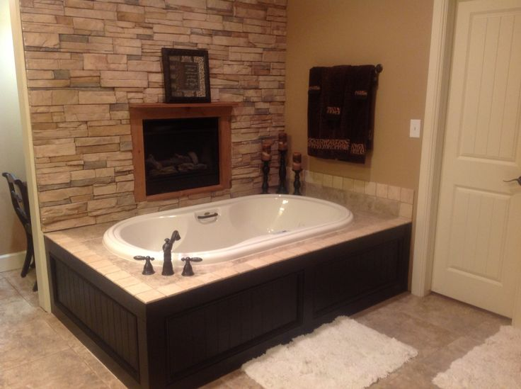 Master bath....dark surround to match cabinets, then faux rock wall.