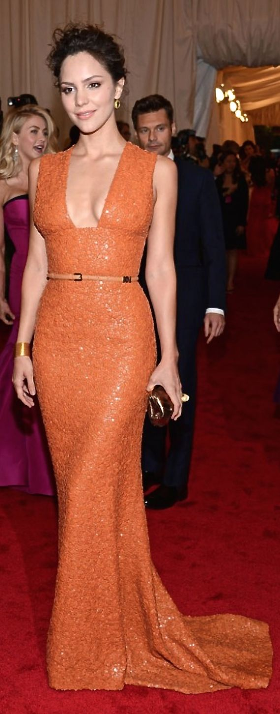 Elie Saab. I just love anything orange. Yes, she's a lefty, watch Scorpion she writes there a lot