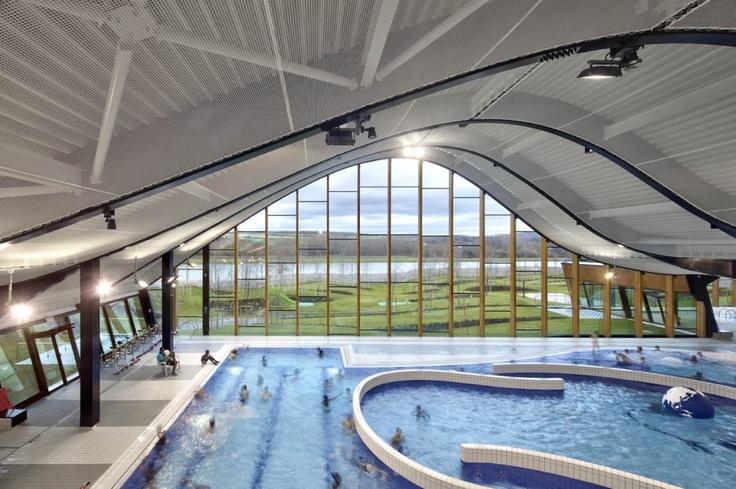 ศูนย์กีฬาทางน้ำ The Mantes La Jolie การผสานสังคมเมืองฝรั่งเศส สู่ธรรมชาติ Tensioned ceiling made with Serge Ferrari Batyline membrane with outstanding features in such an humid environement