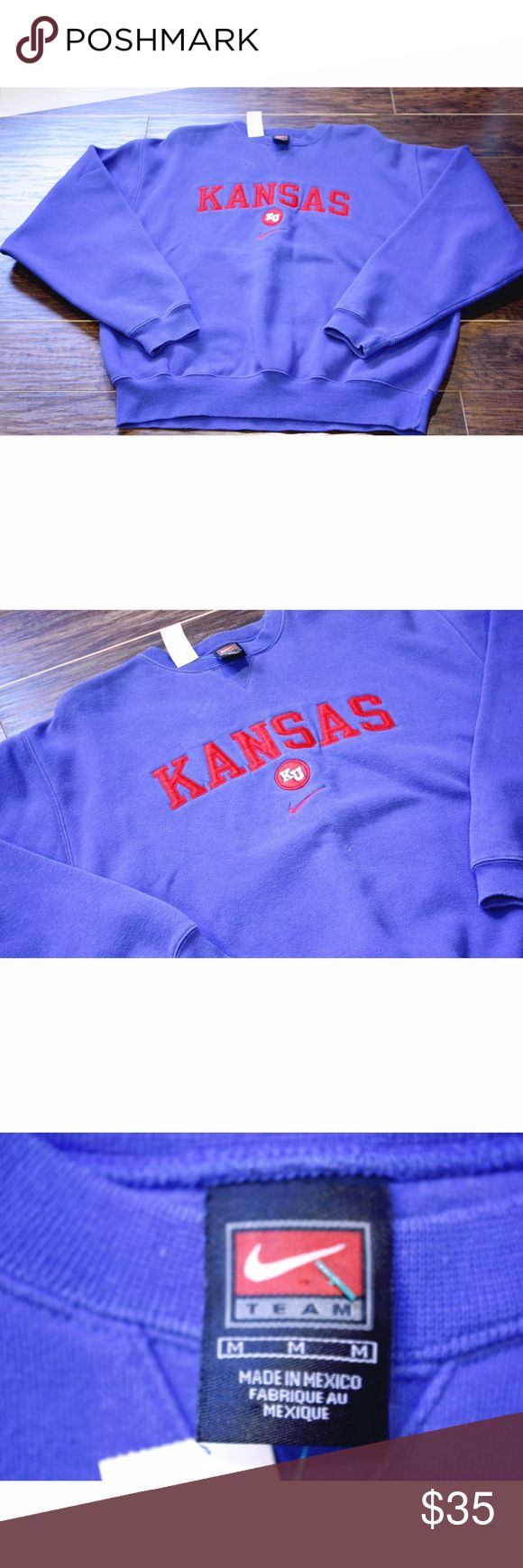 Nike University of Kansas Sweatshirt University of Kansas Nike Crewneck/ Sweatshirt. This is a size Medium. This tag appears to be an older tag. This sweatshirt shows no signs of wear, in great condition! Blue is still very vibrant. Kansas is embroidered along the front. Plain back. All in all this is a great piece to add to your wardrobe. Nike Shirts Sweatshirts & Hoodies