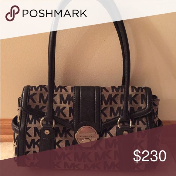 Michael Kors over the shoulder purse Over the shoulder purse used a few times like new. No marks. Contact me for more info Michael Kors Bags Shoulder Bags
