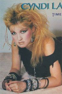 Cyndi Lauper in classic 80s styling.  Hairspray sales soared during this period, whilst the ozone layer wept.