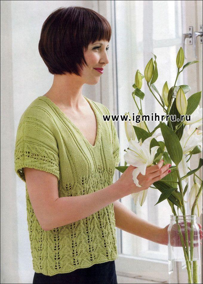 Светло-зеленый пуловер с короткими рукавами и ажурными узорами. Спицы