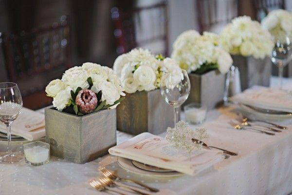 White flower arrangements in square slate vases | floral design by www.poshpetalsfloral.com/ | photography by www.acarrollphotography.com