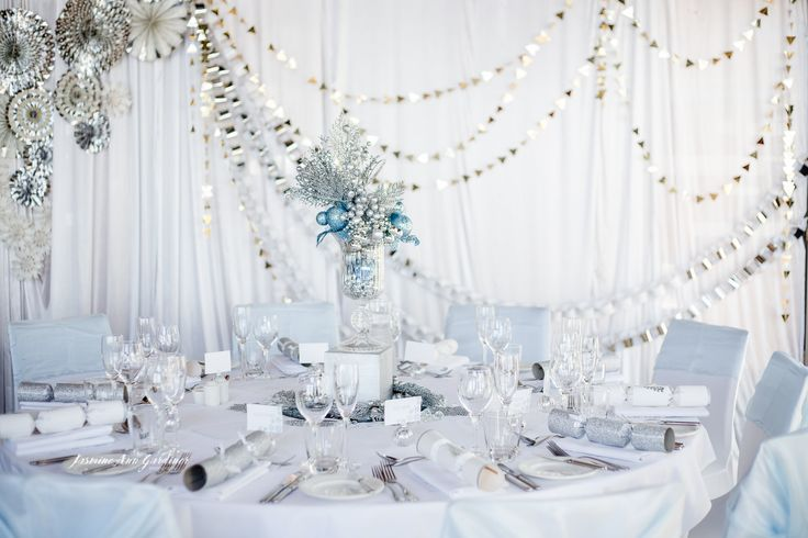 DY.o events (aka Duo) Winter wonderland corporate Christmas event. White, silver and blue styling. Metallic fans and white drapery.