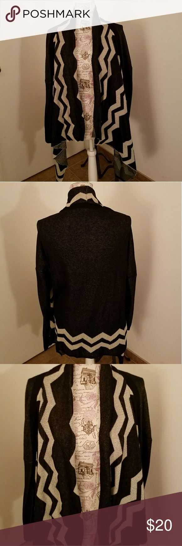 Black & Creme Cardigan Black & Creme Cardigan. Size M/L. In great condition. Sweaters Cardigans