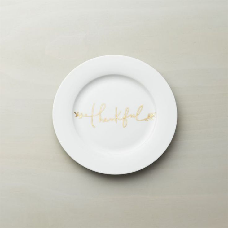 "Shop Thankful Salad Plate.  A graceful message of ""Thankful"" gratitude by artist Kelly Ventura gilds this versatile Thanksgiving accent plate in gleaming gold metallic handwriting with a botanical flourish."