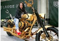 Image: A model sits on a Lauge Jensen motorcycle (© Axel Heimken/dpa/Corbis) $850,000