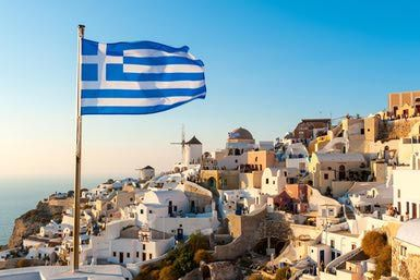 Greek Flag, Oia, Santorini, Greece - Chris Hepburn/The Image Bank/Getty Images