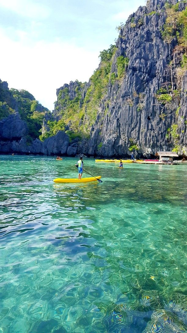 Coron, Philippines — by Brenny Cakes. Lagoons of crystal waters and pink jellyfish... as you go past the cliffs you enter a magical sheltered lagoon with...