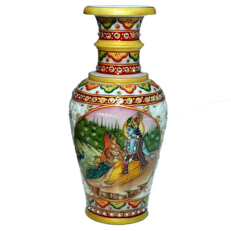 Marble art is an art form started in Rajasthan during the sixteenth century. Marble art is done by carving a marble in various scluptures, articles. This is a classy gift of a flower vase made from marble. The vase is exquisitely crafted, painted and is adorned with lovely kundan work. White faux crystals used to enhance the beauty of vase. This exotic masterpiece beautifully carved from marble is all set to stylize your home uniquely. CLICK here to buy this product - www.kalakhoj.com