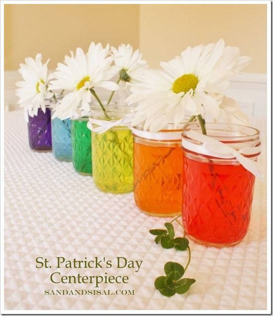 Easy St. Patrick's Day Centerpiece- this would be a fun project for the kiddos to make down the center of the kitchen table! In a few days, the daisies start to change color a bit too!
