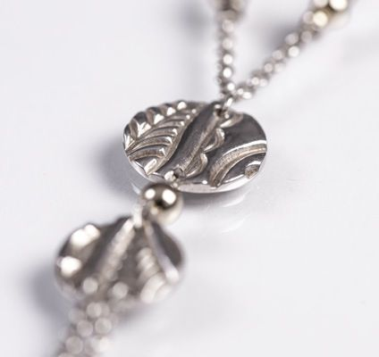 Designed and made by Nuit Nuit. Pure silver (.999) double discs with 9crt gold filled beads on the sterling silver chain