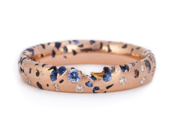 Stunning narrow 18ct rose gold confetti ring with sapphires and diamonds scattered within. We love the raw and organic feel to this wedding band.