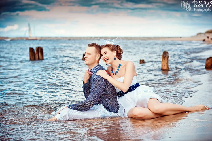 At the shore.  Retro bride and groom do it up!