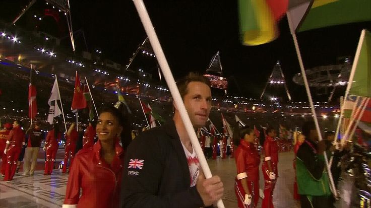 OLYMPIC'S 2012  Team GB: Sailing gold medal winner Ben Ainslie proudly carries the British flag into the Olympic Stadium