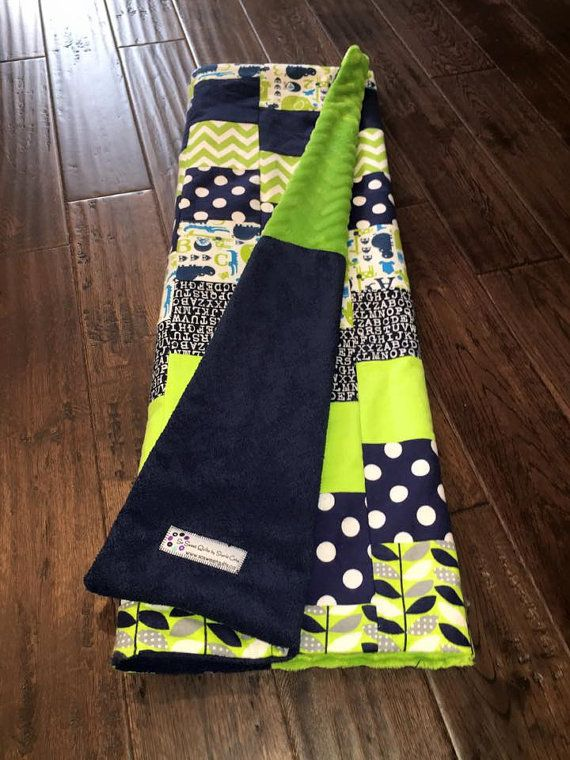 Adorable and modern navy and lime green baby quilt in fun zig zag chevron pattern.