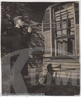 YOUNG MAN BAND UNIFORM PLAYING TROMBONE SHADOWS VINTAGE ARTISTIC SNAPSHOT PHOTO