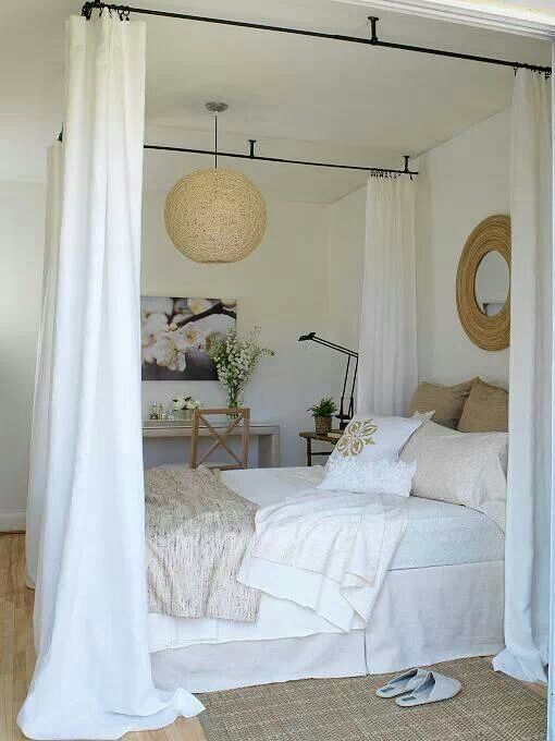 Do it yourself canopy bed with curtains and curtain rods. Like the idea just would use different style materials.                                                                                                                                                                                 Más