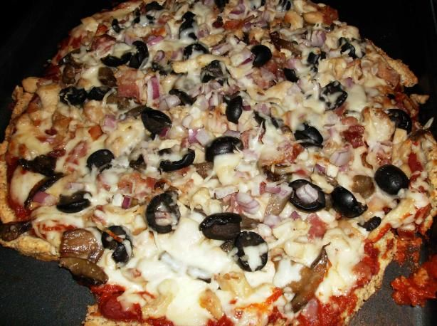 "Primal Pizza - sometimes we just get the craving for pizza.  I follow the Primal Blueprint where fat, protein, veggies and fruit are good from marksdailyapple.com and submitted by ""Son of Grok."" Put whatever toppings you want on this pizza!  	..."