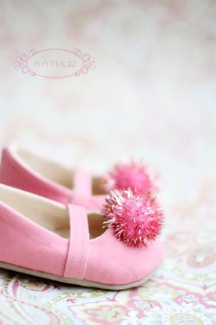 Perfectly pink pom pom shoes.