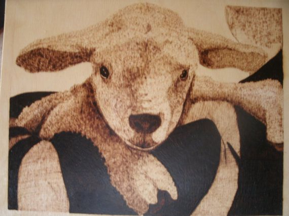 This adorable lamb is almost smiling as he peeks over the shoulder of his shepherd. He rests secure in those strong arms.    This hand burned plaque measures 9.5 inches high by 12 wide, on a piece of birch plywood, stained with natural stain to seal and protect it. Wood burn will not fade, crack or peel like paint. There is a hanger installed on the back for immeciate display.    Great for nursery, family room, any decor. Thank you for looking.  $45.00 plus shipping