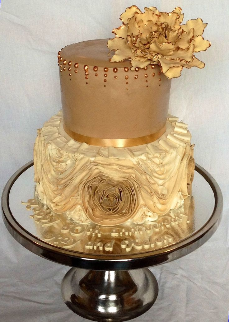Golden wedding anniversary cake - Ruffled bottom tier with lots of golds and shimmer, gumpaste gold peony on top