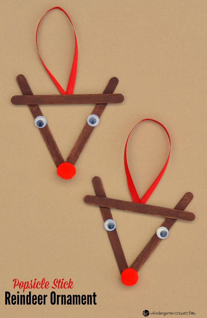 This Reindeer Christmas Ornament was inspired by Rudolph the Red Nosed Reindeer. Create a family Christmas tradition of kid made ornaments with this Christmas craft!