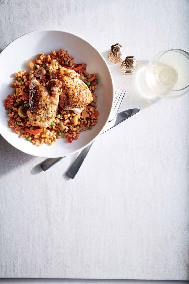 This easy dish is perfect for a casual get-together with friends. Inspired by arroz con pollo, it is hearty with satisfying complexity. Cumin, saffron, and oregano season rich chicken thighs and nutty farro as the dish simmers. If using saffron, deploy it sparingly; those tiny threads bring subtle flavor and a little color to the dish, but too much will yield a medicinal taste. Serve with a side salad to complete the meal.