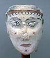 Tête de plâtre peinte, un des rares exemples de plastique monumentale mycénienne, Musée national archéologique d'Athènes.