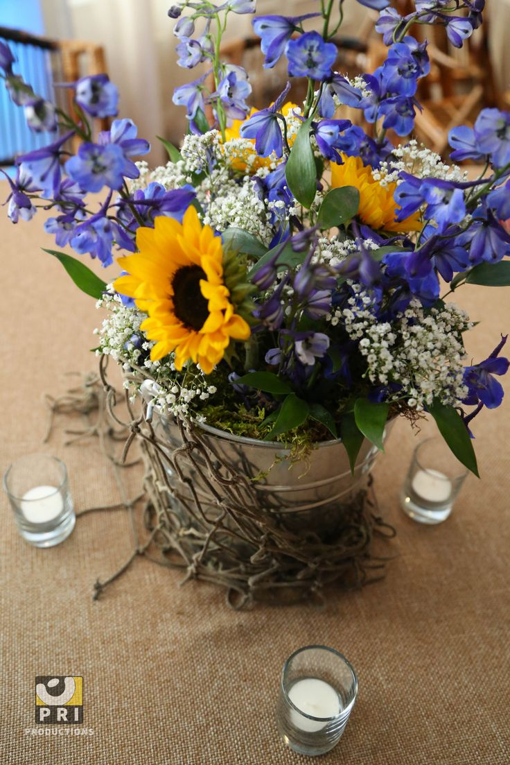 Rustic center piece with sunflowers.