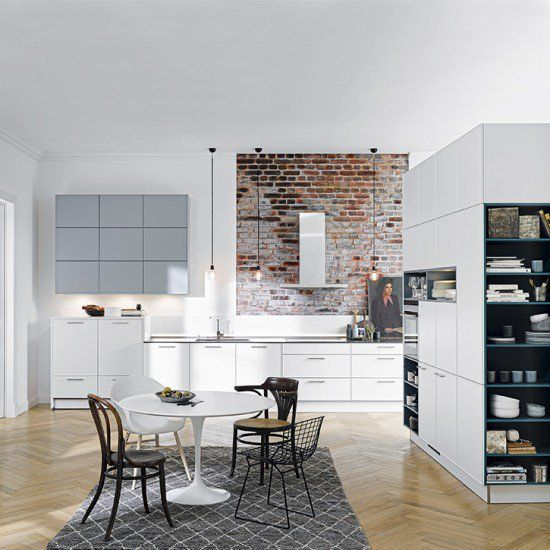 Kitchens: Modern Kitchen With Brick Wall Also Round Dining Table Plus Gray  Rug And Handleless Cabinetry