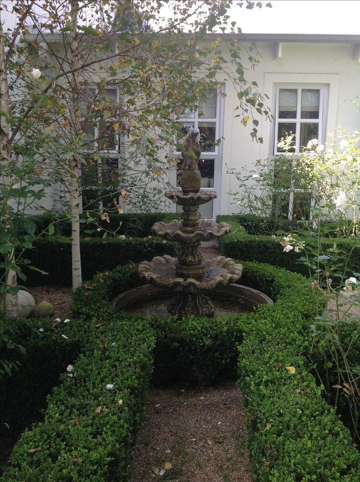 Abbey Guesthouse  courtyard fountain