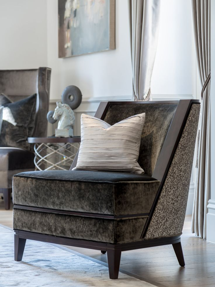 Acting as a statement piece, the grey tones of this bespoke chair contrast with the living room design and bring a touch of vivacious luxury in its irresistible Casamance fabric. #interiordesign #luxurylife #luxury #london #luxuryproperty #luxuryhomes #londonproperty #luxuryinteriors