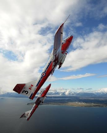 Snowbird 1 of the Canadian Forces Snowbirds, an air demonstration team from 431 Squadron Moose Jaw, Sask., flies over the Comox area April 17, 2009 while training for the 2009 air show season.     CF Photo by MCpl Robert Bottrill © 2009 DND-MDN Canada