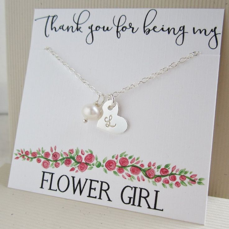 Personalized necklace gift for flower girl. Hand stamped initial on heart shaped charm with cultured freshwater pearl. Available in sterling silver.