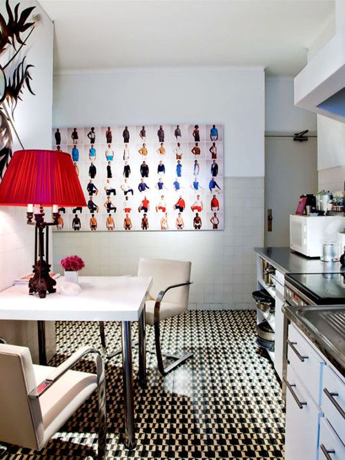 Bold apartment from Design Milk. Kitchen. Dining. Tile Floor. Red Accents. Decor. Interiors. Home.