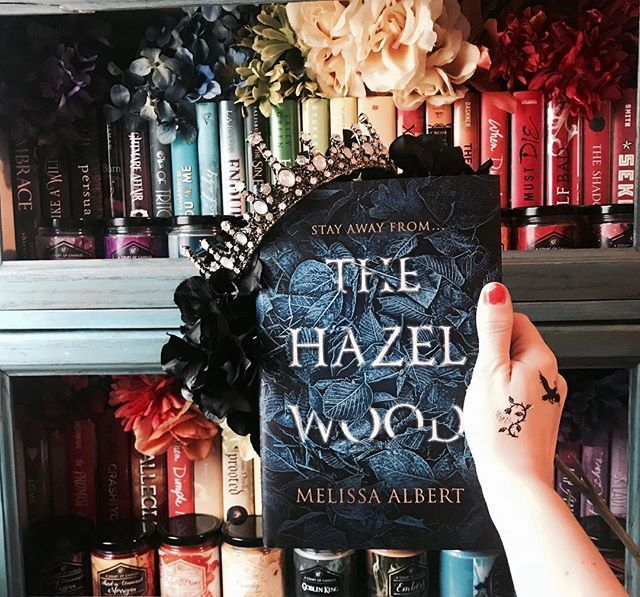 What is your favorite fairytale???? . I dont really know if I have a favorite I just love fairytales of any kind! Ive heard that The Hazel Wood by @melissaalbertauthor is an amazing fairytale and Im hoping to read it soon!!! . This stunning copy came in the February @fairyloot box! Its such a pretty cover and I paired with some tattoos I git from the publisher! . If you are interested in trying out #fairyloot use code DFT5 to get 5% off a 3 or 6 month subscription! . Synopsis…