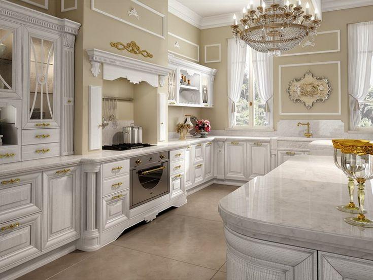 luxury white kitchen design with brass chandelier over white marble top kitchen island