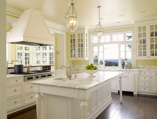 25 best ideas about yellow kitchens on pinterest yellow for Blue kitchen cabinets with yellow walls