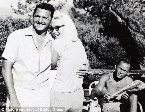 Final days: In a never-before-seen photograph, a young Buddy Greco poses with Marilyn Monroe, as Frank Sinatra looks on, at the notorious Mafia haunt, Cal-Neva Lodge
