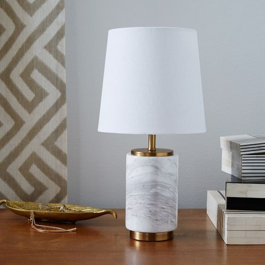 Featuring a marble-finished base and white linen shade, the Pillar Table Lamp looks right at home in a mid-century room. Its size and scale are perfect for a desk or side table.