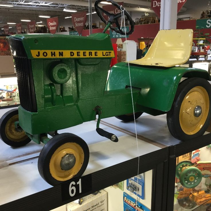 Vintage John Deere tractor pedal car from the 1970's by ERTL is original except for the new pedals. Wonderful lawn and garden nostalgia toy!  $1,400. above Case 61