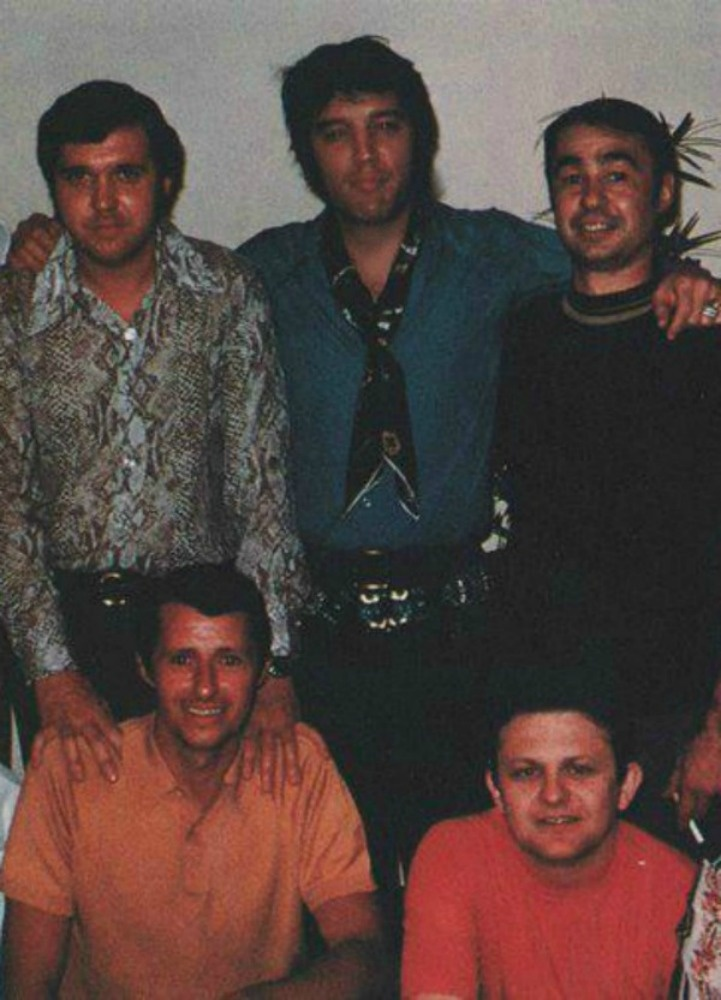 Elvis with four of his body guards...aka Memphis Mafia...the others were cut out of the photo.