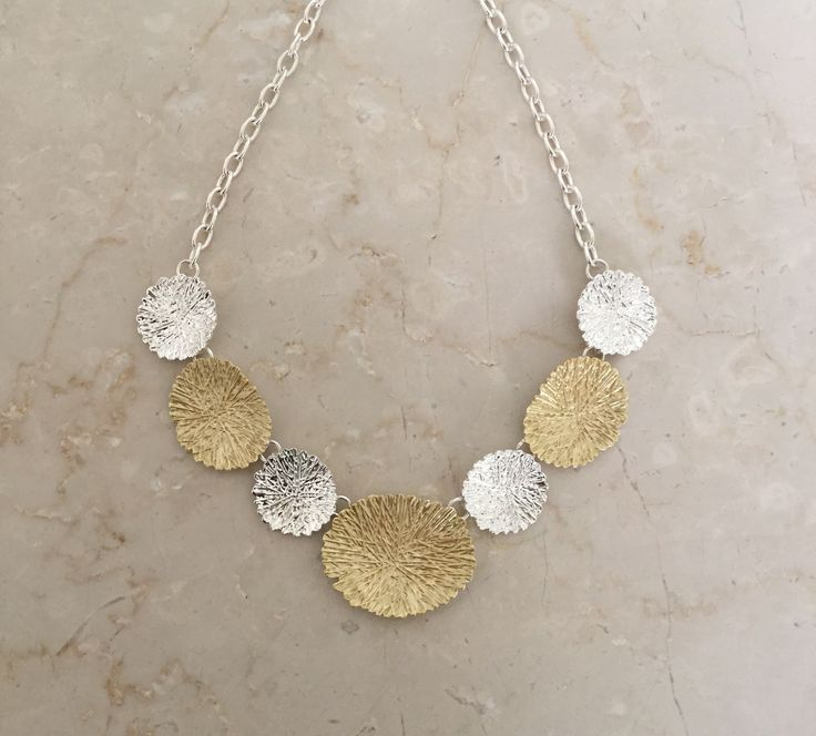 Unique Fashion Jewellery Australia - Gold and silver ovals shatter effect necklace, $58.00 (http://www.uniquefashionjewellery.com/gold-and-silver-ovals-shatter-effect-necklace/)