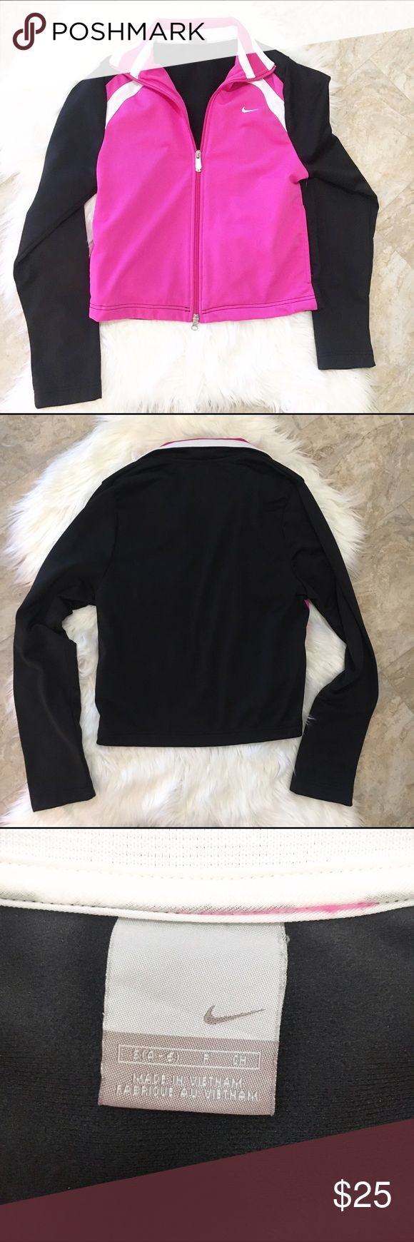 Pink and Black Nike Zip Up Sweat Shirt Pink, black and white Nike zip up sweatshirt in excellent condition. No stains or pulling. 100% polyester. Nike Tops Sweatshirts & Hoodies